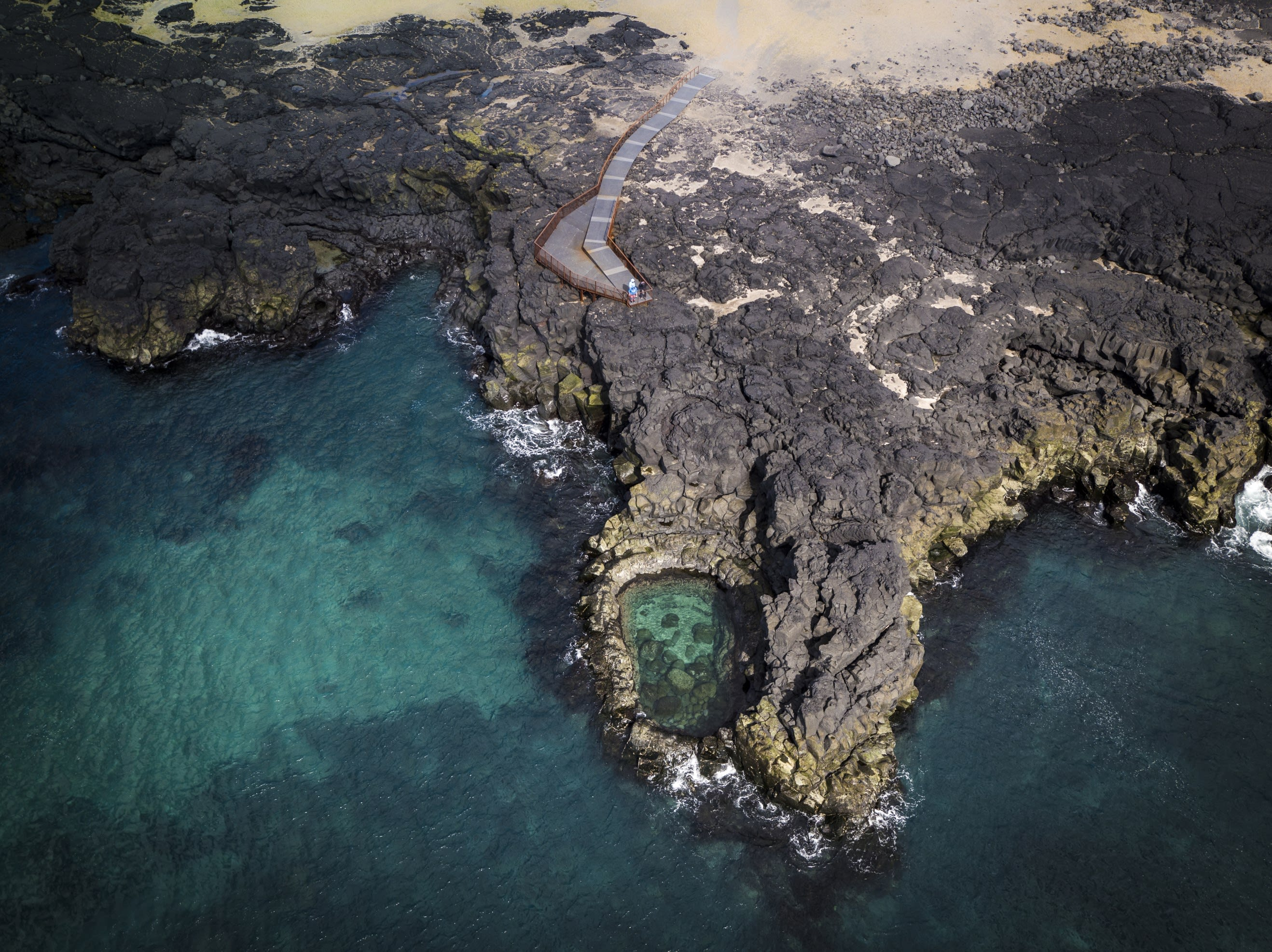 Brimketill, a small body of water contained in Iceland's rocky shoreline