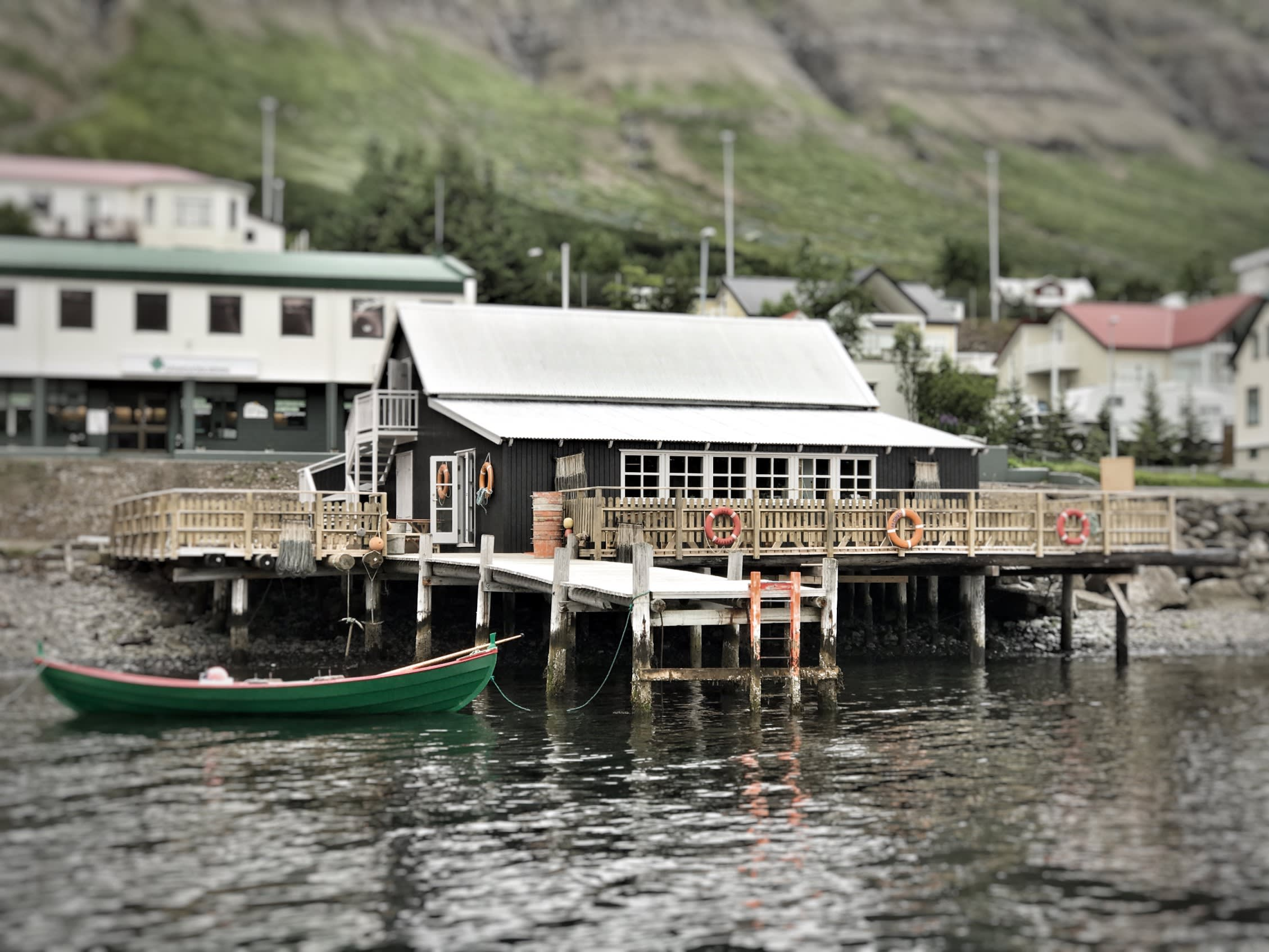 The Bait Shack, a black nautically decorated building, pictured here from the sea side