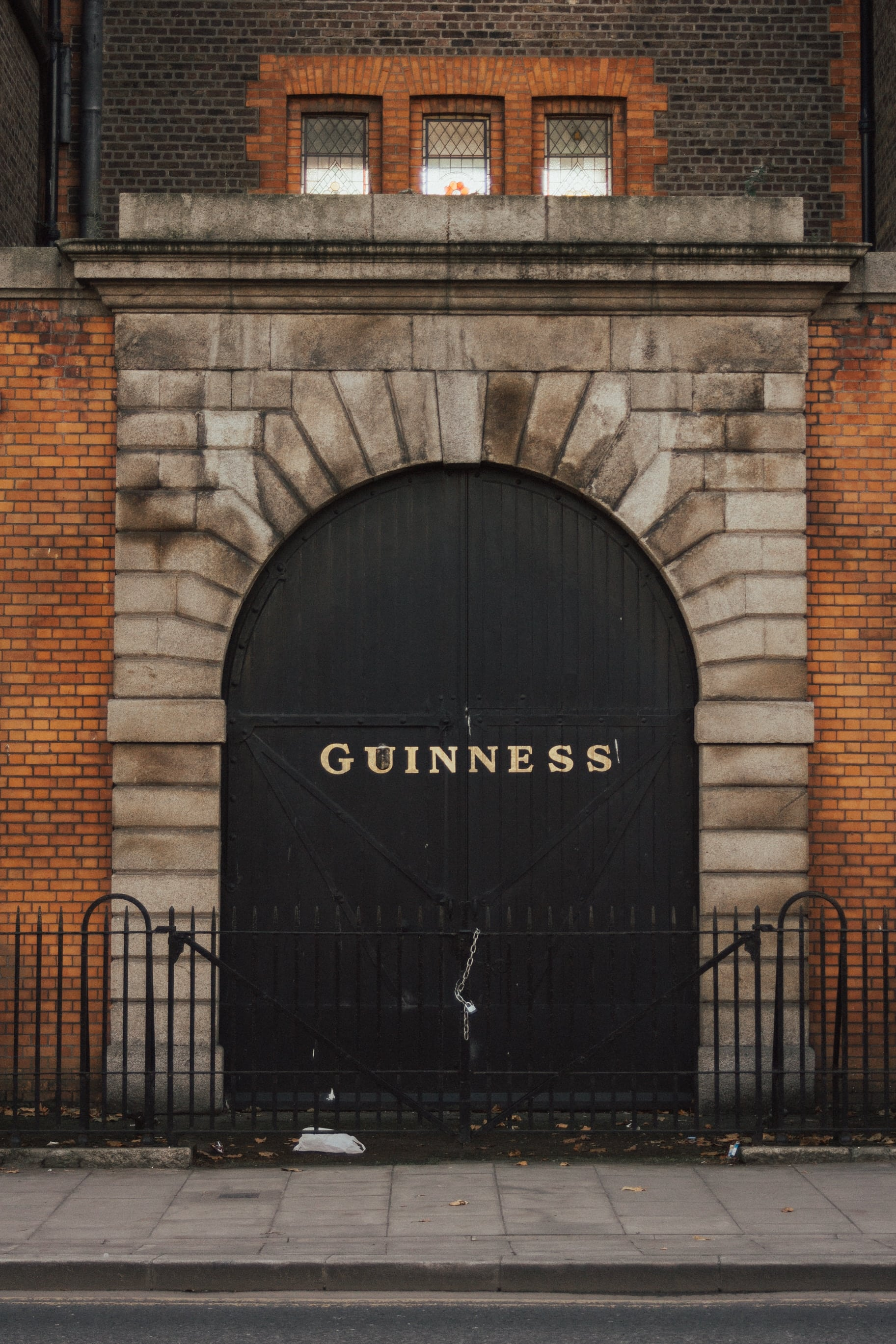 the arched stonebuilt entrance to a Guiness brewery in Dublin