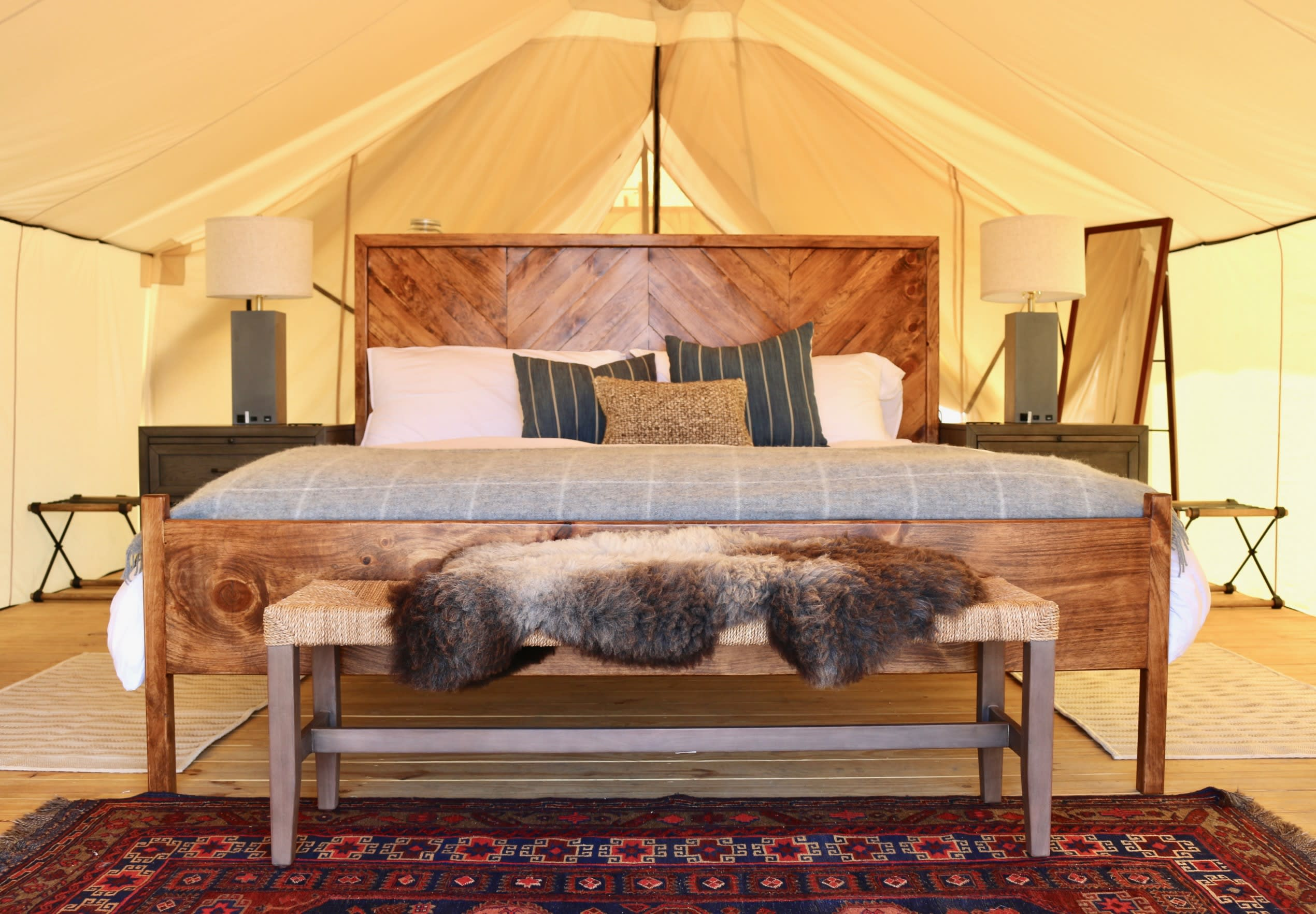 the inside of a camping yurt with luxury design features throughout