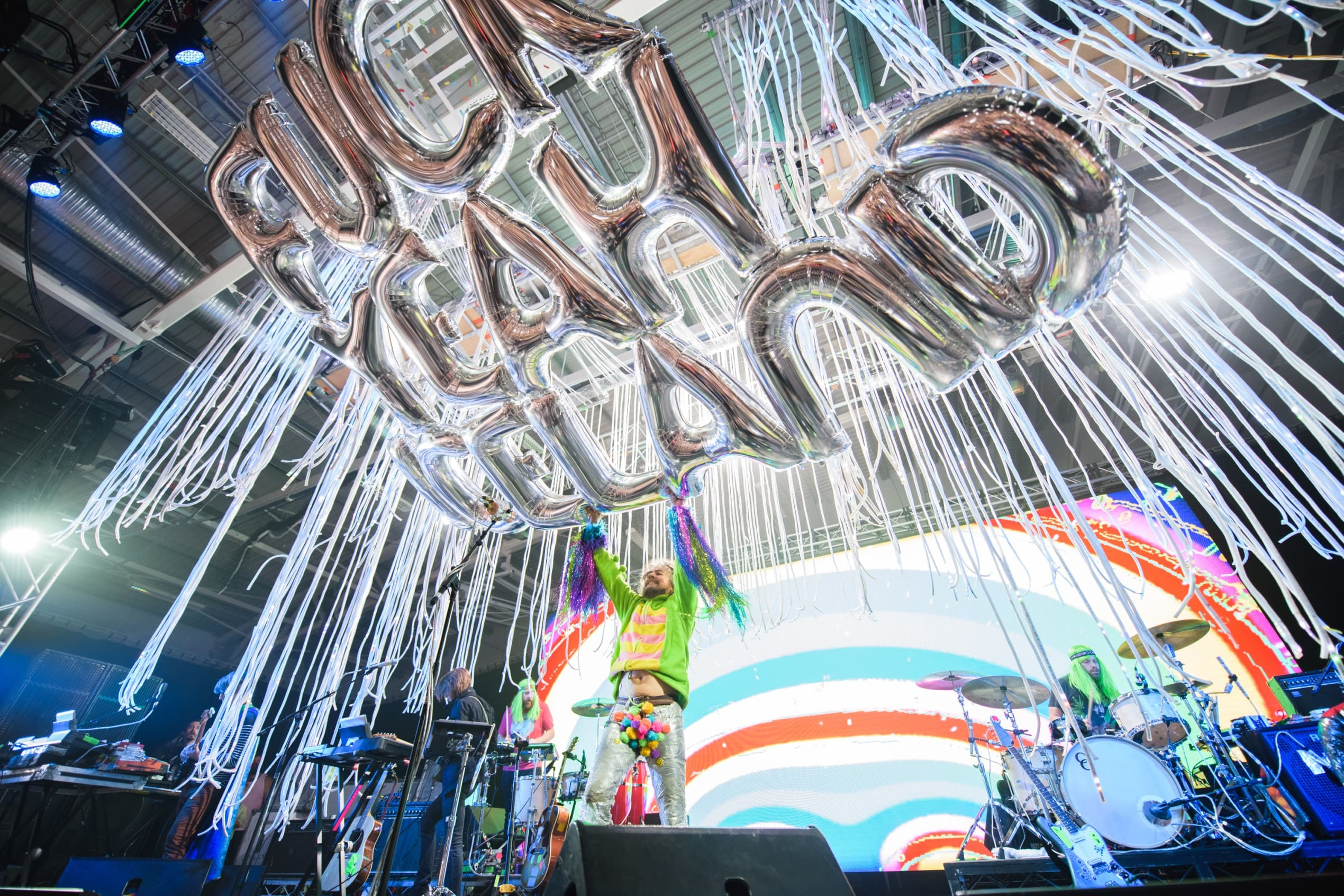 The Flaming Lips performer releases a large silver balloon that reads 'F*ck Yeah Iceland' into the crowd