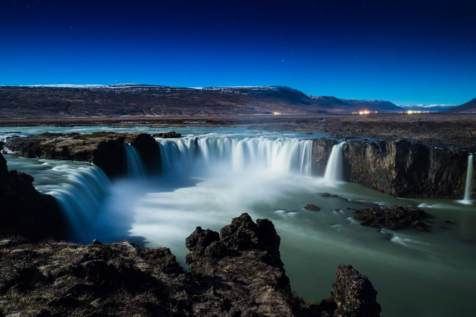 An image of Godafoss waterfall in North Iceland on a bright blue sky day