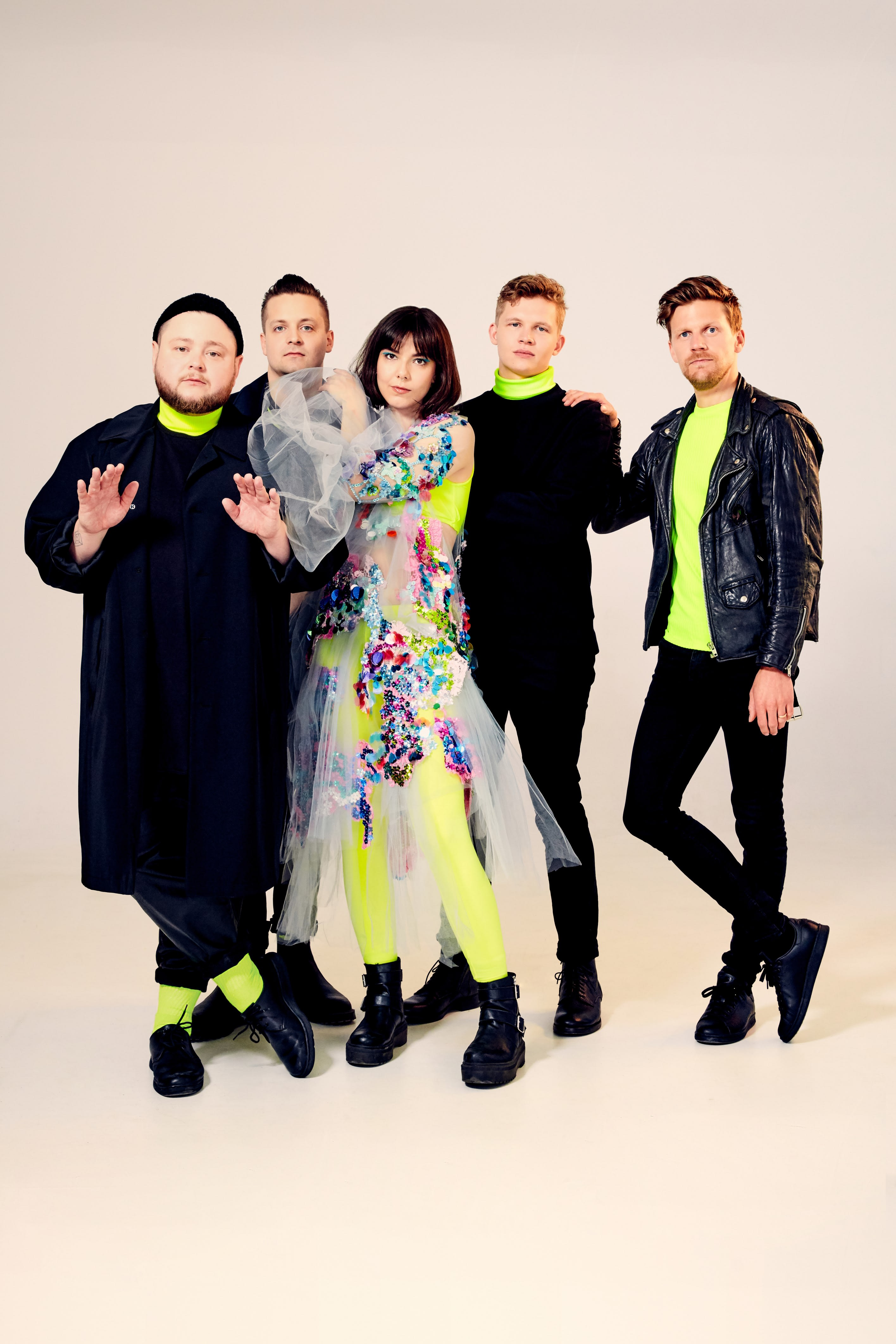 All five members of the Monsters and Men band pictured here with coordinating black and neon yellow outfits