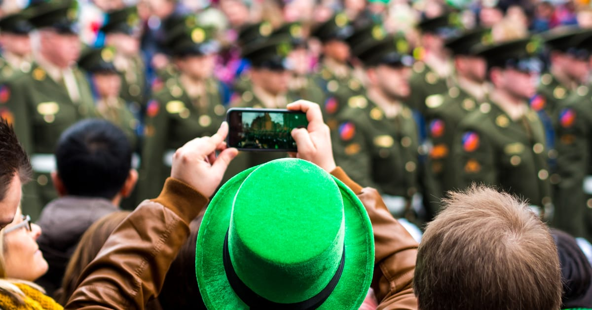 St Patrick's Day celebrations in Boston viewed from the perspective of a person wearing a green top hat and filming the green guard