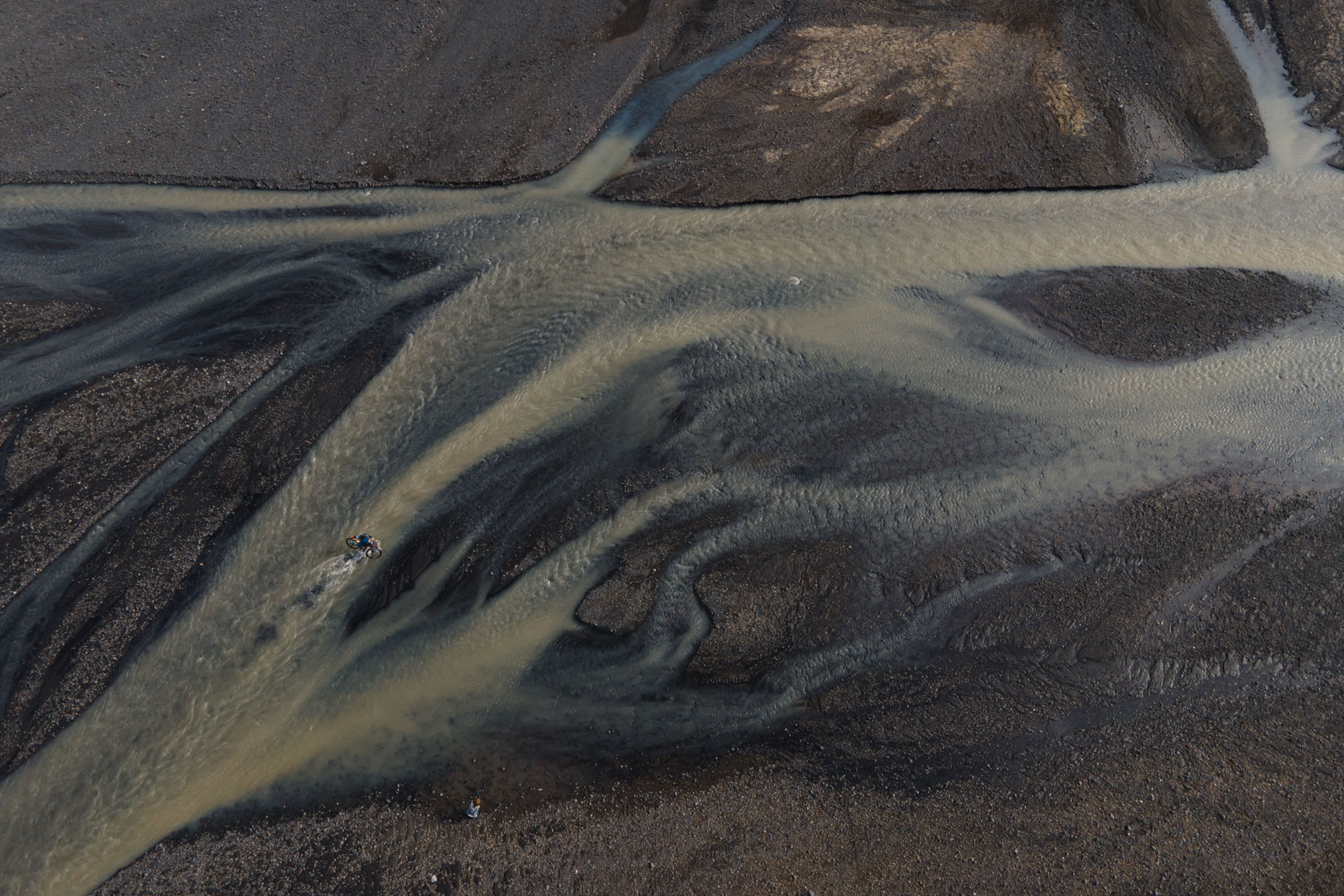 an aerial view of glacier rivers in Iceland