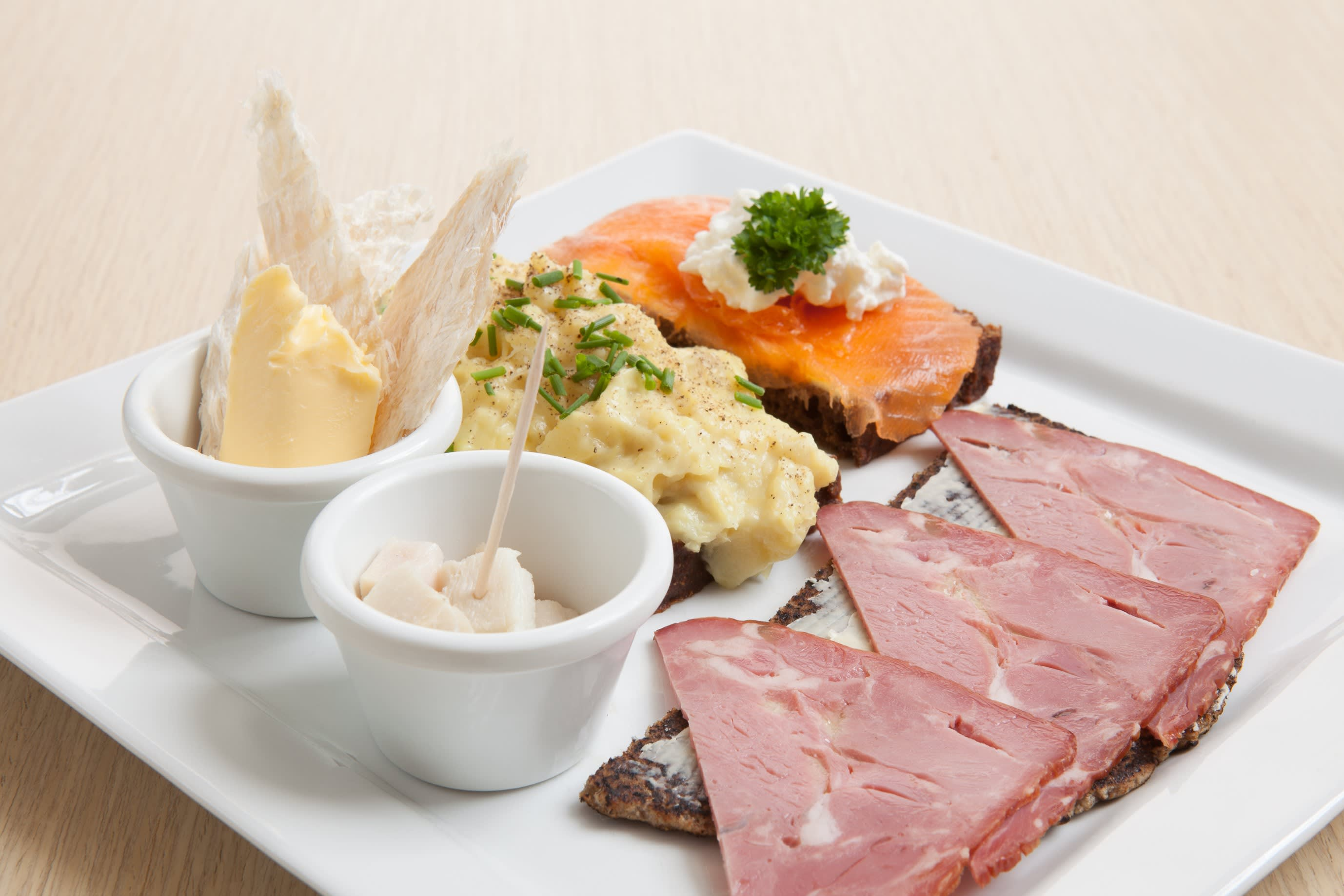a plate for Thorablot celebrations in Iceland - displaying various fish and meats on Icelandic breads data-verified=