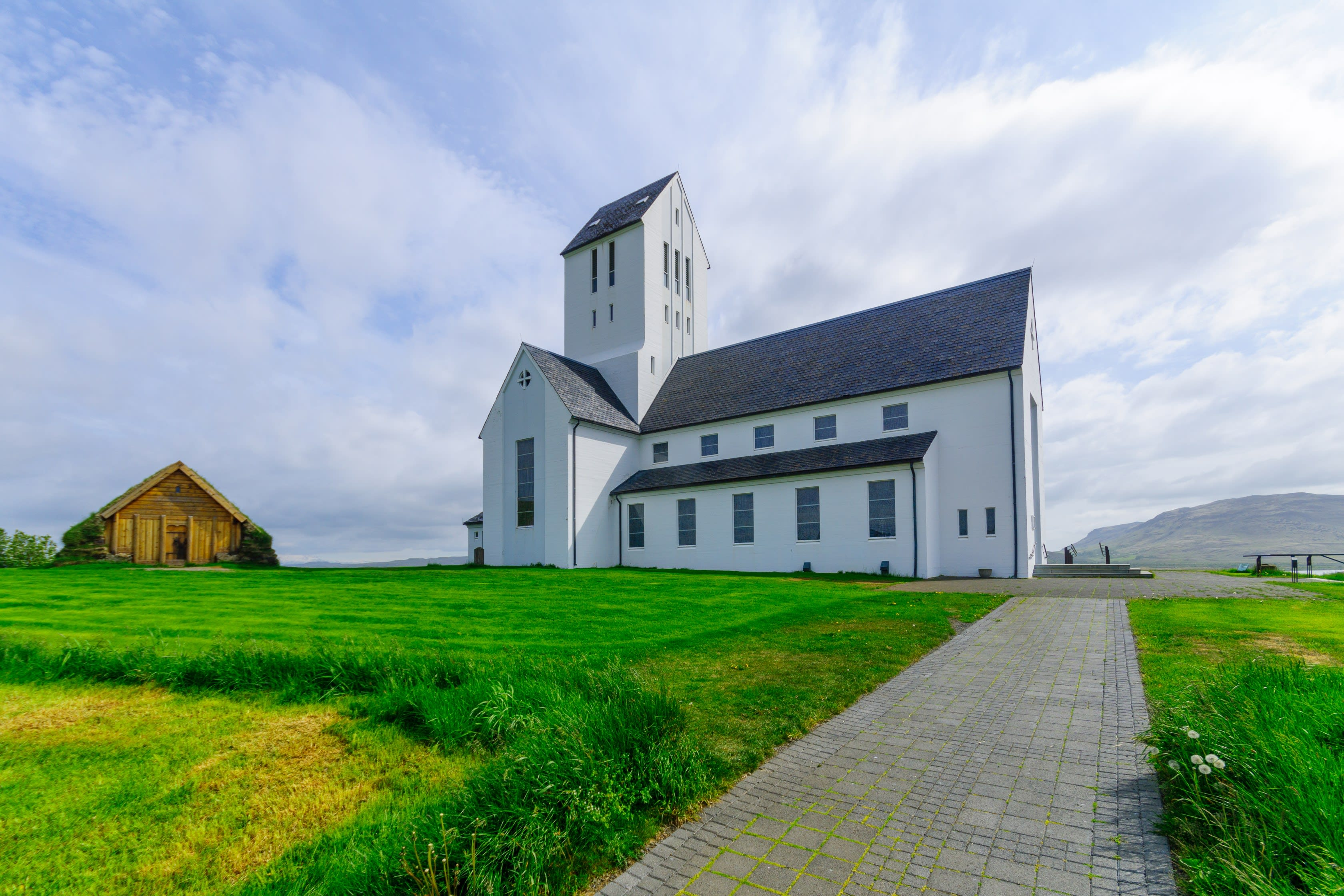 The cathedral at Skalholt viewed on a bright summers day with verdant greenery in the foreground