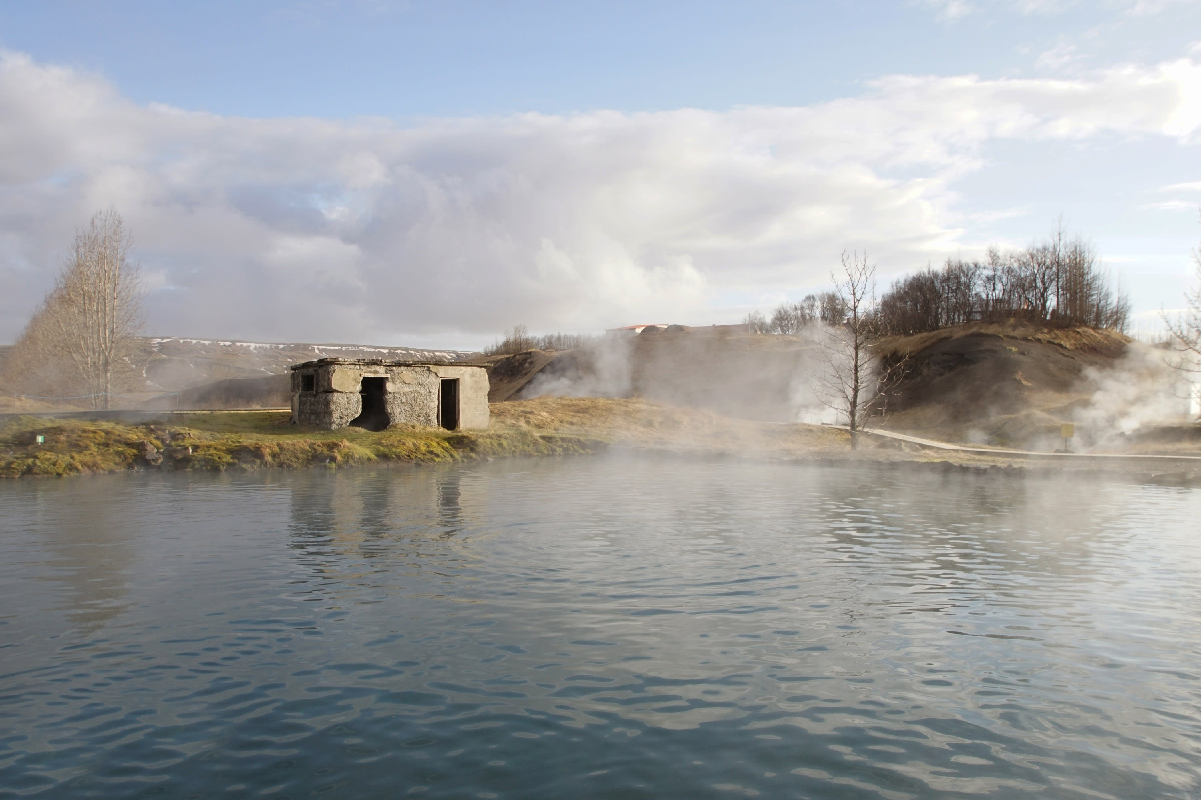 The Seecret Lagoon at Fludir with steam coming off from the warm geothermal water
