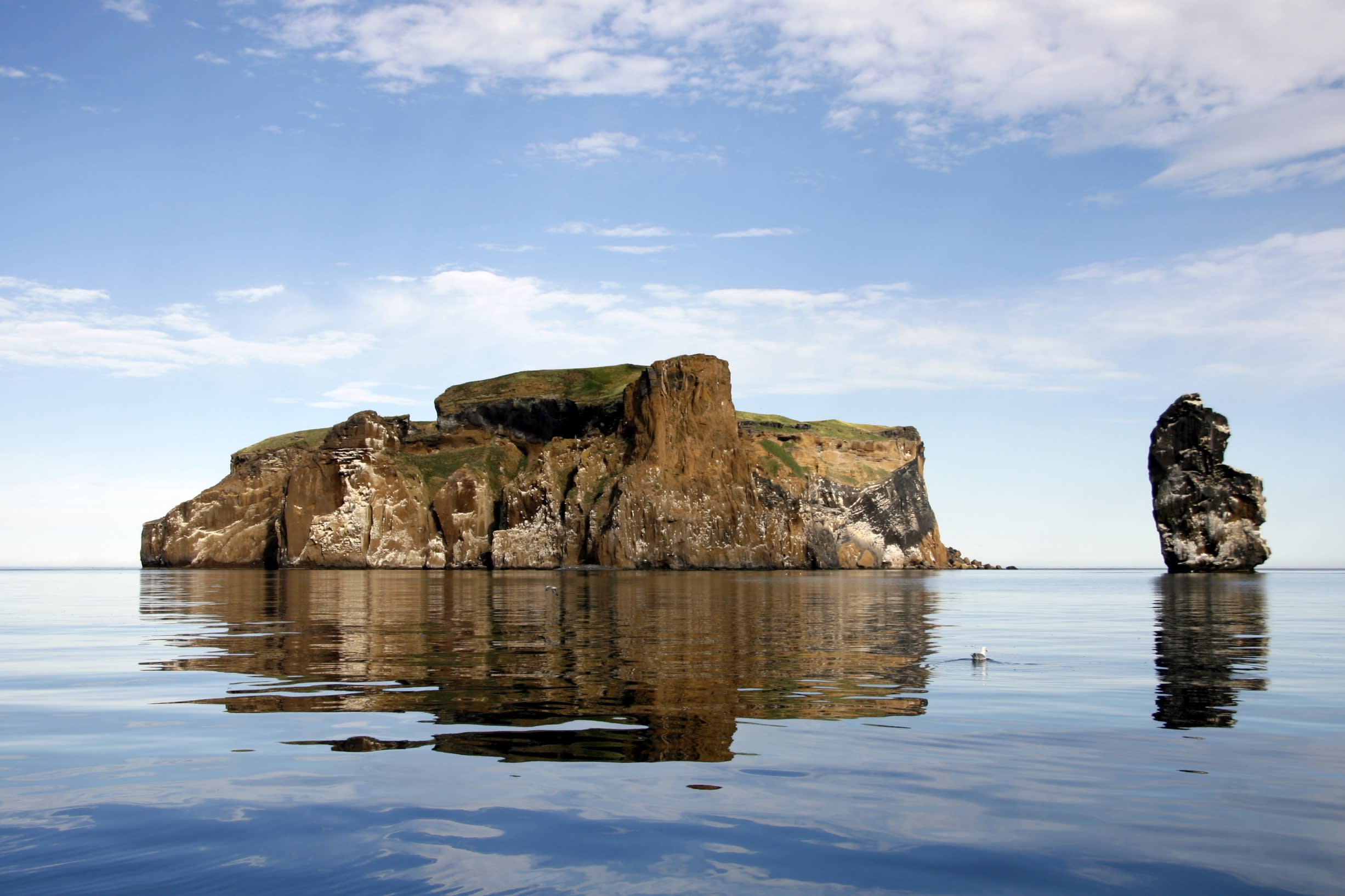 A rocky islet in Iceland called Drangey, pictured here on a bright summers day