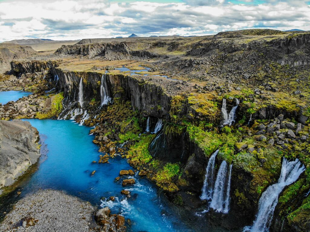an aerial view of Hraunfossar waterfall in the West of Iceland