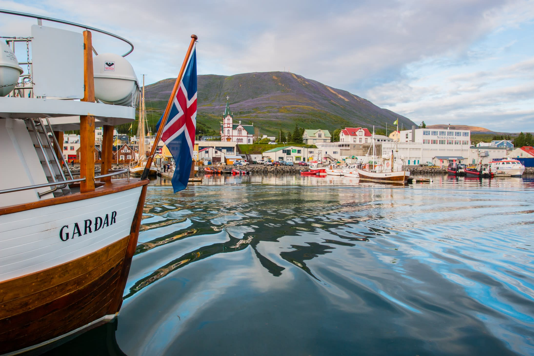 The harbour in Husavik, in North Iceland, viewed from out at sea on a boat