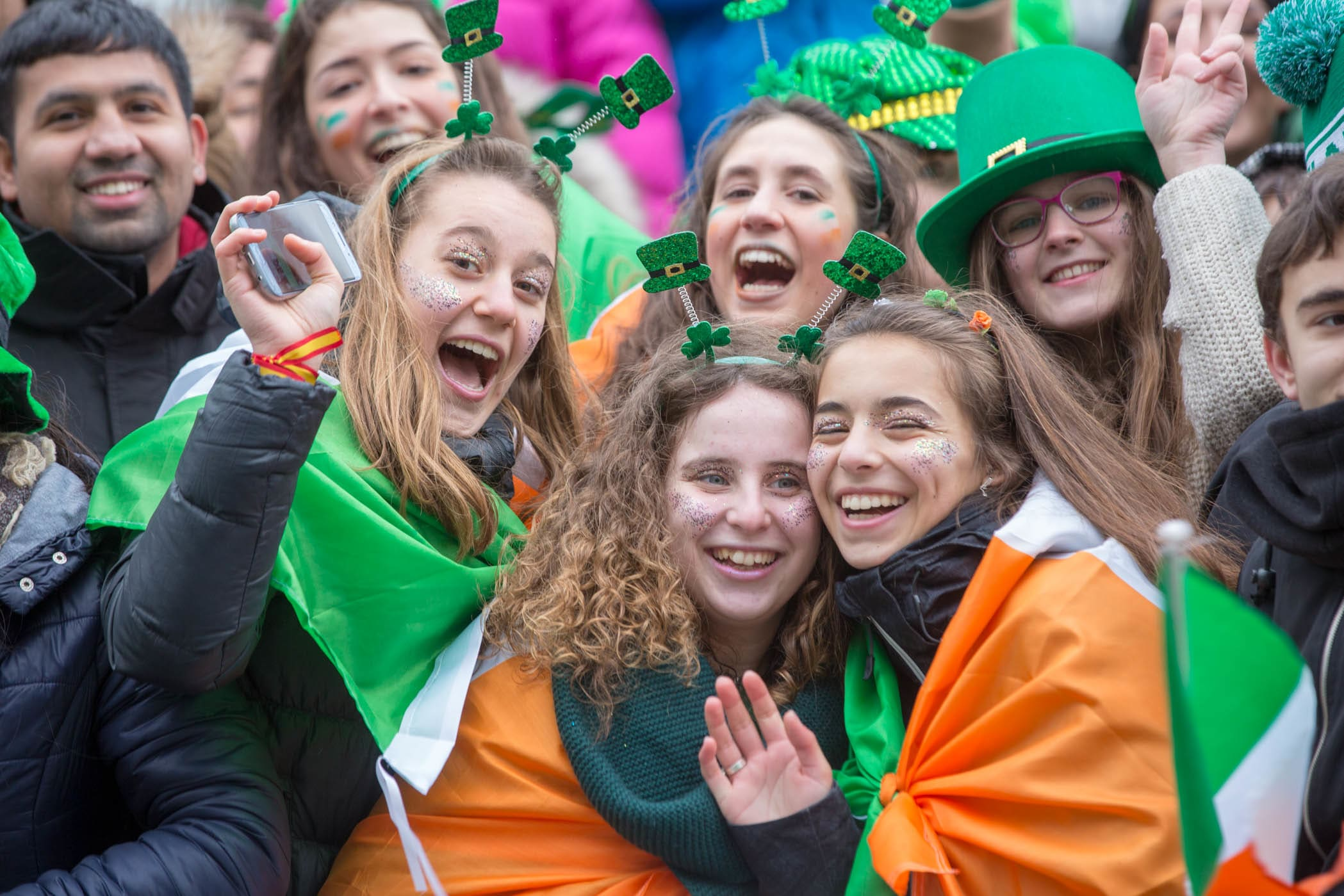 A group of young people celebrating St Patricks Day in Dublin, wearing lots of Irish themed memoriabilia