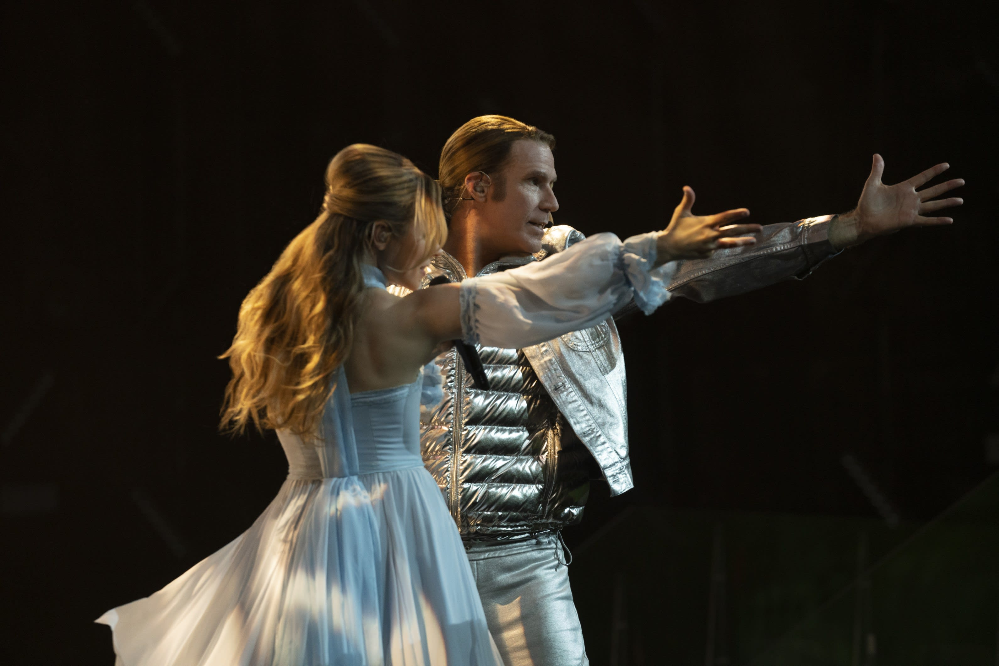 Will Ferrell and Rachel McAdams dancing on stage at Eurovision while they sing together