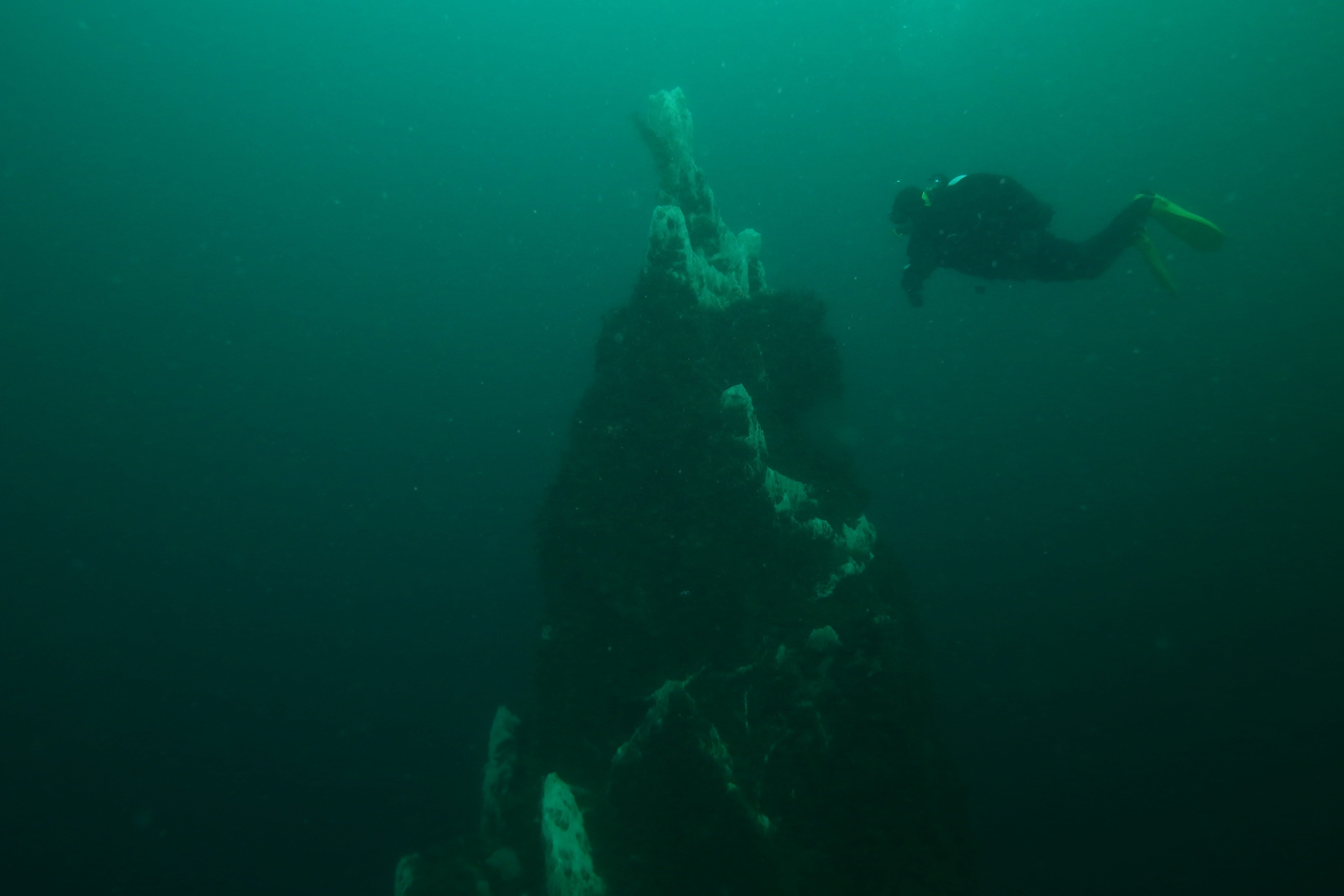 a scuba diver pictured underwater at Strytan in Iceland